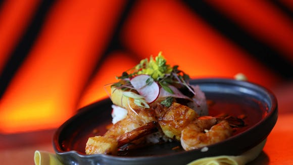 Shrimp skewers with sticky chive rice, one of the dozen menu items at the Love Shack.
