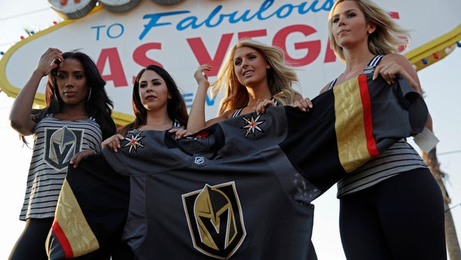Models unveil the Vegas Golden Knights' new hockey jersey on Tuesday in Las Vegas.