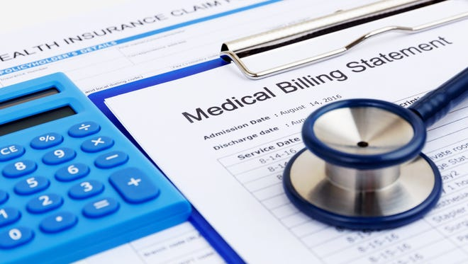 Getty Images/iStockphoto Why is being required to buy health insurance different from workers being forced to pay Social Security and Medicare taxes? Medical bill and health insurance form with calculator