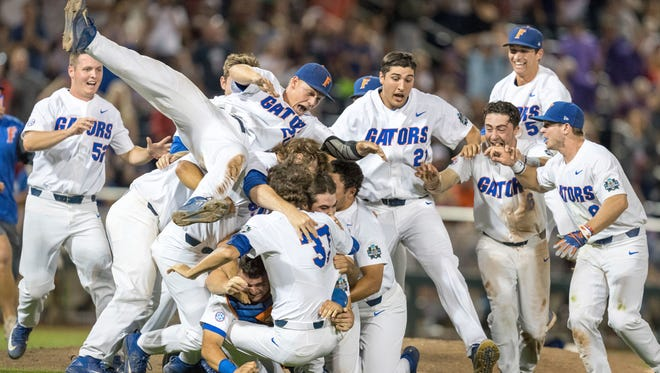 Florida celebrates after defeating LSU in Game 2 of the NCAA baseball College World Series finals Tuesday.