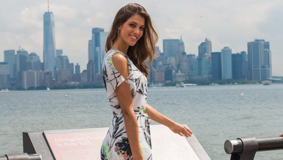 Miss Universe Iris Mattanaere poses after a Statue
