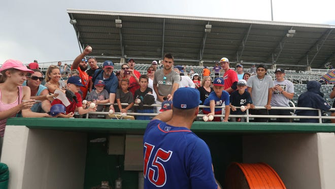 The area behind the two dugouts at Hammond Stadium will have protected netting rising 30 feet from it in time for 2018 spring training. Tim Tebow, shown here, signed autographs for fans during his midsummer, 2017 visit to the ballpark while with the St. Lucie Mets.