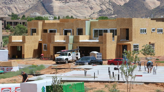 Construction crews hard at work on new housing in the Ledges subdivision of St. George on Tuesday, July 18, 2017.