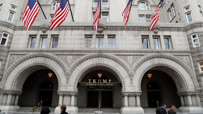 President Trump's company operates a hotel just down the street from the White House that is among the businesses at the center of disputes about potential conflicts of interest that government-paid lawyers are now defending him against.