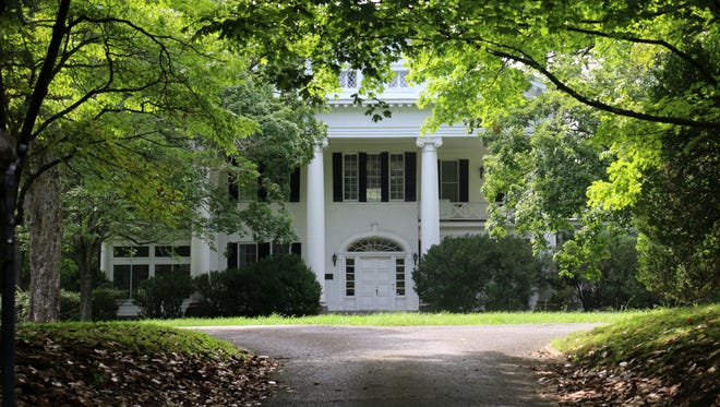 The 19-house development would go behind the historic home known as Mayberry House, a white neoclassical-style home on the National Historic Register.