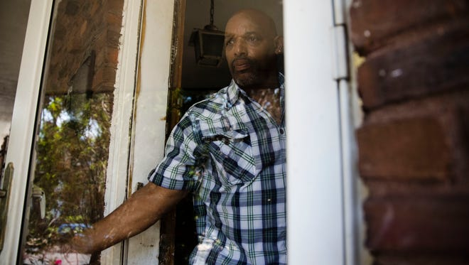 """Earl Rice Jr. steps out of his home in Wilmington, Del., Thursday, May 18, 2017. Jailed at 17 for a purse-snatching that took a woman's life, he is 61 now. """"For 43 years I'm behind a wall or some kind of a fence with guard towers ... and then you come out here,"""" he says. """"I can imagine what Buzz Aldrin and Neil Armstrong and them felt like going to the moon, because that's what it seems like. I'm on a different planet!"""" (AP Photo/Matt Rourke)"""