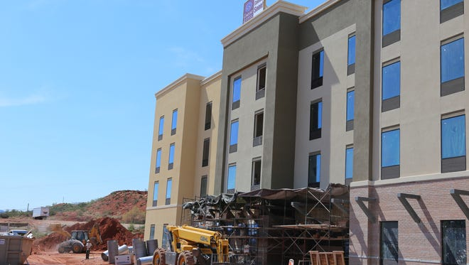 Construction crews continue work on a new hotel in St. George on Thursday, Aug. 3. New hotel construction is at a record pace in southwestern Utah in 2017.