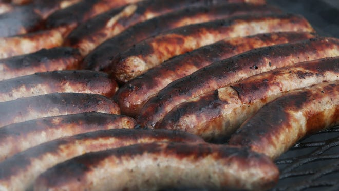 Brats on the grill at Brat Days at Kiwanis Park Friday August 4, 2017, in Sheboygan, Wis.