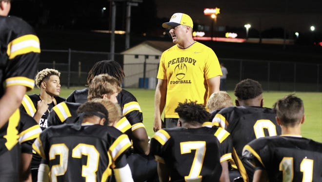Trenton Peabody coach Shane Jacobs talks to his team after scrimmaging Chester County during the summer.
