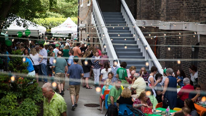 Attendees mill around at the 10th annual Irish Fest on the Hill at the Immaculate Conception Church in downtown Knoxville on Aug. 12, 2017.