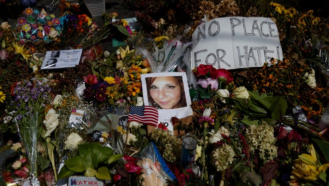 A photo of Heather Heyer, who was killed during a white nationalist rally, sits on the ground at a memorial the day her life was celebrated at the Paramount Theater on Aug. 16, 2017 in Charlottesville, Va.