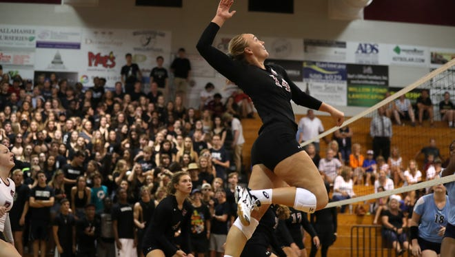 Chiles' Aly Freeland leaps to spike the ball against Maclay at Chiles High School Thursday, Aug. 24, 2017.