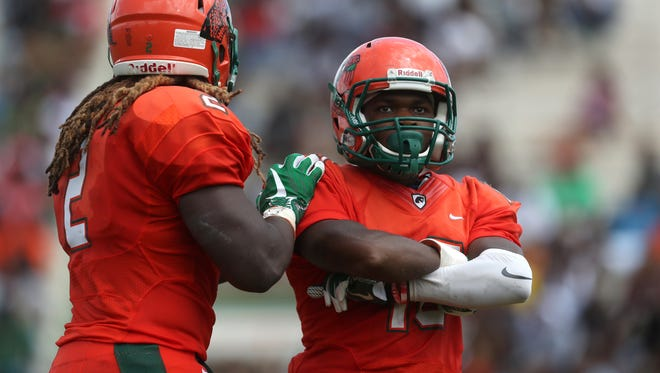 FAMU's Orlando McKinley poses after getting a hit in the backfield against Texas Southern during the Rattlers home opener at Bragg Stadium on Saturday, Aug. 26, 2017.