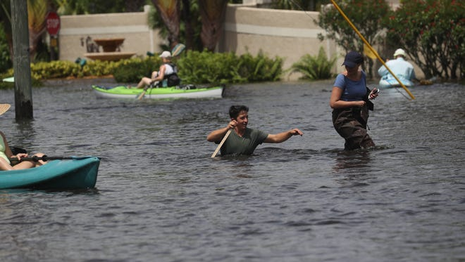 Heavy flooding has swamped the Island Park neighborhood after three days of relentless rains and a high tide. Some residents are being rescued by emergency personnel.  Residents are saying some first-floor units have 2-6 inches of water in them.