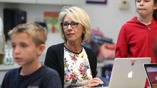 U.S. Education Secretary Betsy DeVos joins Marci Russell's fifth grade class on a visit to Holy Comforter Episcopal School on Tallahassee's east side last week.