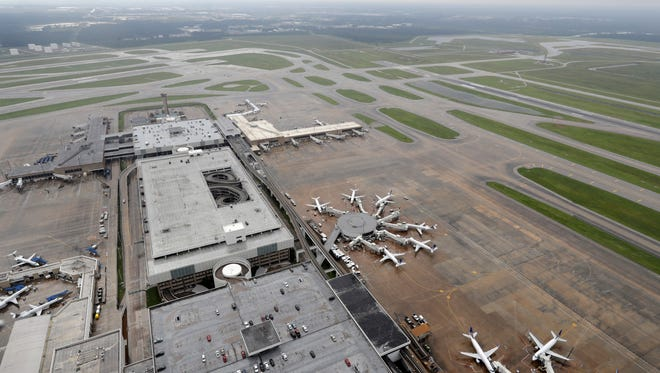 Planes are parked at Houston's Bush Intercontinental Airport on Tuesday, Aug. 29, 2017. The airport was closed at the time because of Hurricane Harvey.
