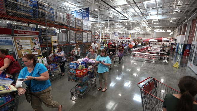 Shoppers fill the checkout lines at Costco, in preparation for Hurricane Irma last year.