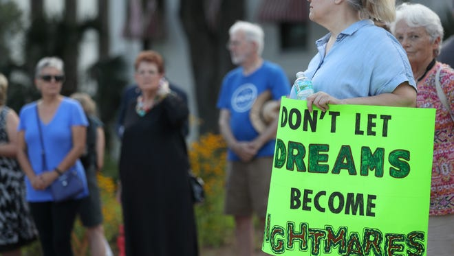 Dozens of people rally in support of Deferred Action for Childhood Arrivals, known as DACA, outside of the Capitol Tuesday, Sept. 5, 2017.