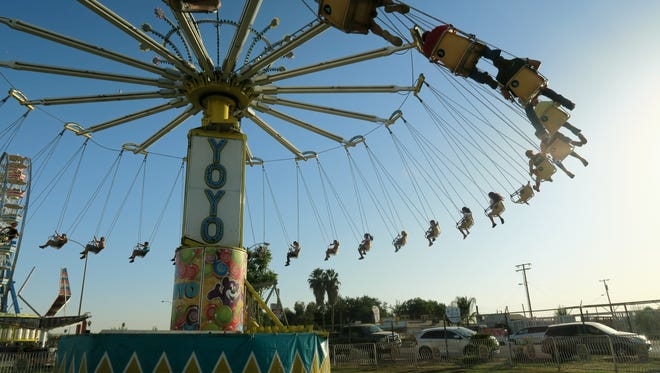 Fair-goers enjoy the YoYo Swings at the Tulare County Fair.