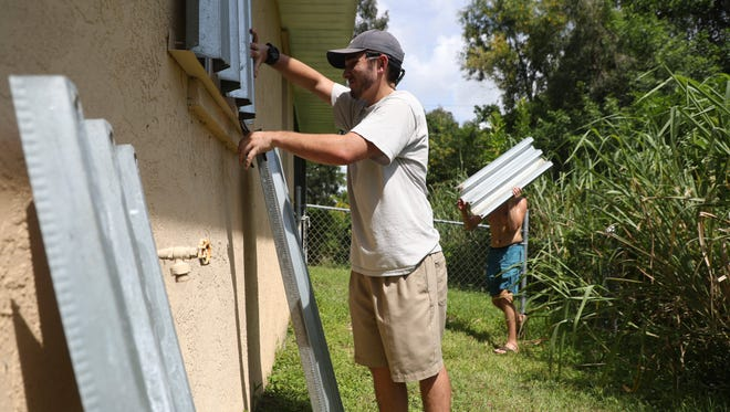 Lee County residents are preparing for the worst and hoping for the best in the event of Hurricane Irma. They were boarding up homes and filling sandbags and buying supplies.