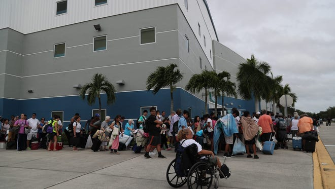 Thousands of evacuees wait outside Germain Arena to take shelter before Hurricane Irma on Saturday, Sept. 9, 2017.