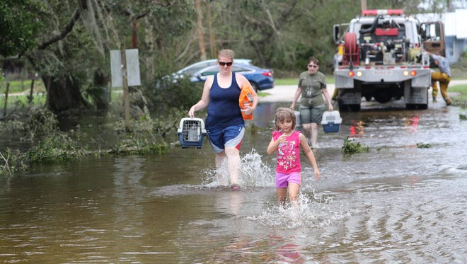 Residents of Buckingham and Lehigh Acres faced flooding and downed trees from Hurricane Irma.