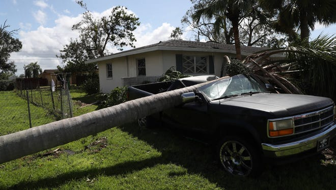Images from effects of Hurricane Irma on Lehigh Acres, Florida on Monday.