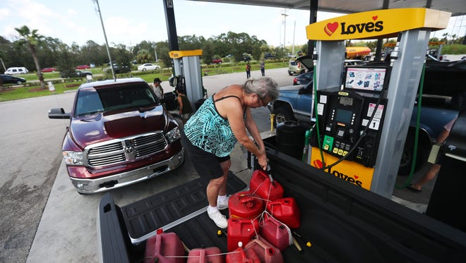North Fort Myers resident Linda Peters fills her gas tanks at the Love's convenience store off of Bayshore Road in North Fort Myers on Tuesday. She had to wait over an hour to get gas and found places out of fuel at several stations before arriving at the Love's.