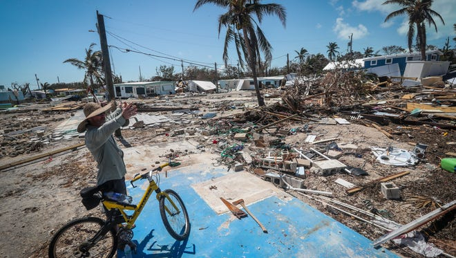 Bill Quinn talks about how big his field of debris is as he searches for anything salvageable from his long time family owned mobile home that was destroyed. He stands on the foundation where it once stood. Sea Breeze RV and Mobile Home Park in Islamorada, FL, was devastated by Hurricane Irma. Many of the Mobile home owners were in the park trying to salvage anything they could from their homes on Wednesday, September 13, 2017. Some of the mobile homes were flooded, moved, or completely destroyed.