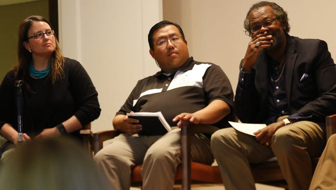 Katie Rosenberg from the Marathon County Board, Yee Leng Xiong from the D.C. Everest School Board and Tony Patterson, the chair of the Diversity Affairs Committee, were three of the participants in the Community after Charlottesville town hall on Wednesday.