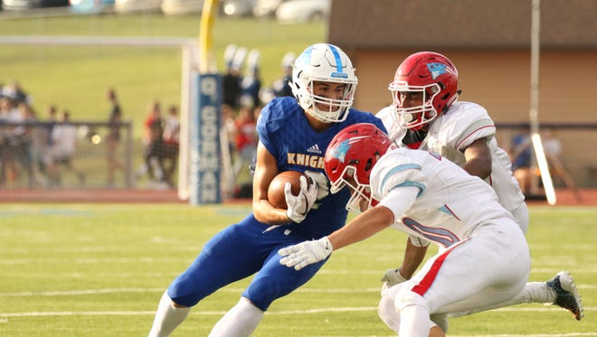 Max Tibbetts of O'Gorman attempts to get past a couple of Lincoln defenders after a reception during Friday's game at O'Gorman.