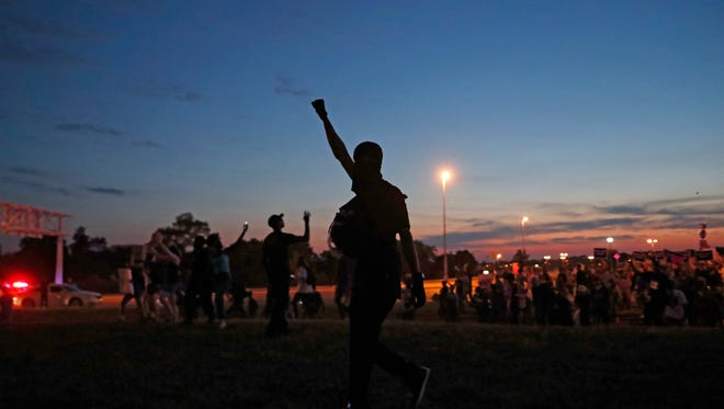 Protesters march, Friday, Sept. 15, 2017, in St. Louis, after a judge found a white former St. Louis police officer, Jason Stockley, not guilty of first-degree murder in the death of a black man, Anthony Lamar Smith, who was fatally shot following a high-speed chase in 2011. (AP Photo/Jeff Roberson)