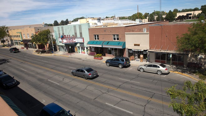 Many vehicles pass through the lanes of West Main Street, seen here on Tuesday, Sept. 19, on the way to other parts of town. This part Farmington sees sparse pedestrian use by day and little at night. An ambitious plan by city officials will try to turn the well-traveled thoroughfare dotted with thriving businesses and empty storefronts into a busy and pedestrian-friendly business and entertainment hub.