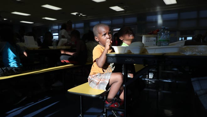 Families impacted by Hurricane Irma receive a meal at Franklin Park Elementary School in Fort Myers, Florida on Monday 9/18/2017.  The food was provided by the Red Cross, cooked by the Southern Baptist Convention Disaster Relief Team and brought/served at the school by the Salvation Army alongside Franklin Park Elementary and other school district teachers and staff.