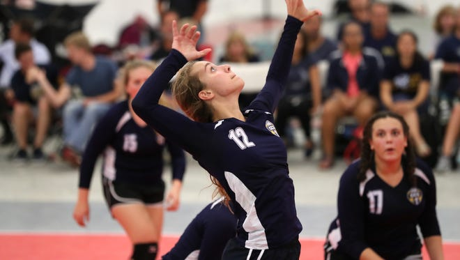 Community Christian's Abbie Post leaps to spike the ball during their match against NFC at the ProStyle Volleyball Academy on Tuesday.
