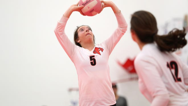 NFC's Haley Grant sets the ball during their match against Community Christian at the ProStyle Volleyball Academy on Tuesday.