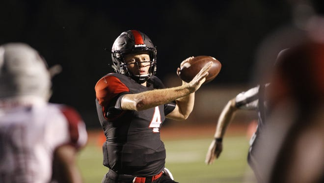 Davidson quarterback and Gulf Breeze High product Tyler Phelps looks to pass against Guilford on Sept. 16 in Davidson, North Carolina.