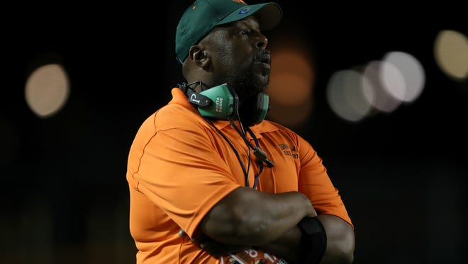 FAMU DRS' Head Coach Cedric Jones leads his team from the sidelines as they take on Jefferson County during their Friday night game at Bragg Memorial Stadium.