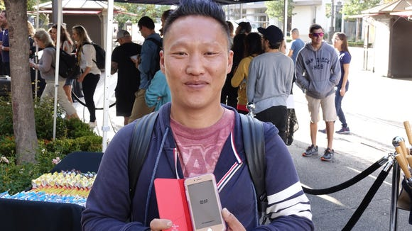 Matthew Lee shows off his new iPhone 8. He was first