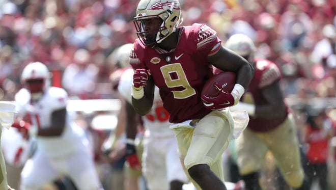 FSU's Jacques Patrick runs the ball against NC State during the Seminoles home opener at Doak Campbell Stadium on Saturday.