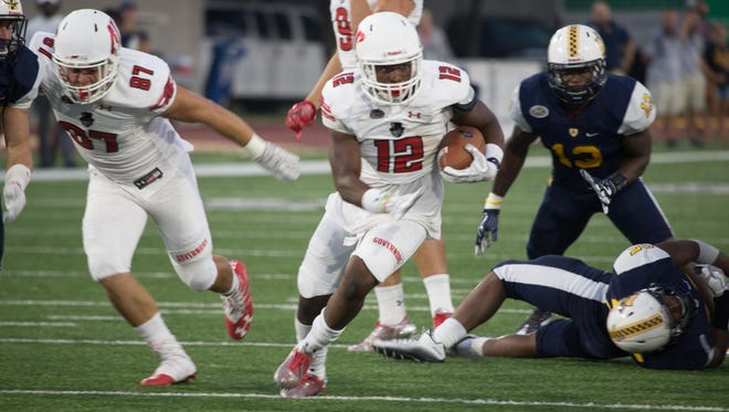 Austin Peay running back Tre Nation carries the ball against Murray State.