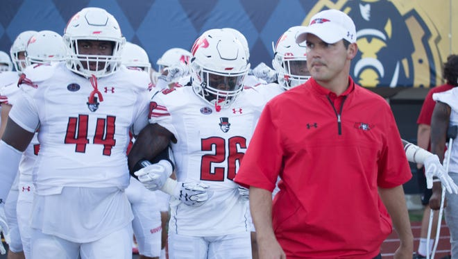 Austin Peay coach Will Healy stands with his team during Austin Peay's game vs. Murray State.