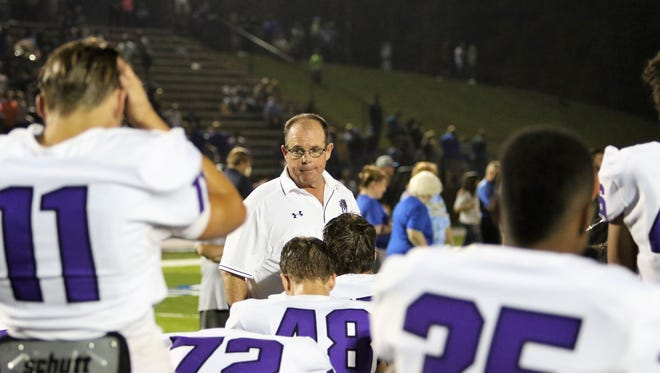 Milan coach Jeff Morris talks to his team after the Bulldogs played Huntingdon on Sept. 22, 2017.