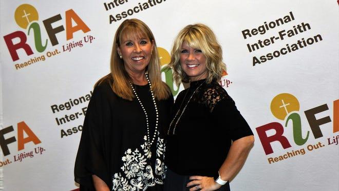 RIFA Executive Director Lisa Tillman and guest artist Natalie Grant Thursday at RIFA's 2017 Canstruction Awards Banquet at the Carl Perkins Civic Center.