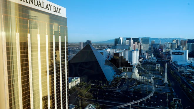 The Mandalay Bay Resort and Casino, at left, stands across the street from a festival grounds on Oct. 3, 2017, in Las Vegas. Authorities said Stephen Craig Paddock broke windows on a high floor of the hotel and began firing with a cache of weapons, killing dozens and injuring hundreds at a music festival at the grounds. (AP Photo/Marcio Jose Sanchez) ORG XMIT: NVMS102
