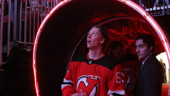 Jesper Brett of the Devils before coming back onto