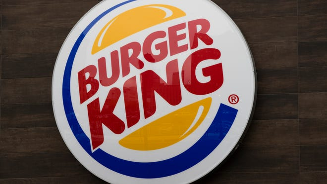 This Friday, Oct. 21, 2016, photo shows a Burger King restaurant logo in Philadelphia. Burger King is adding spicy nuggets to its menu and firing up a rivalry with burger chain Wendy's, which pulled the peppery snack from most of its restaurants earlier in 2017.