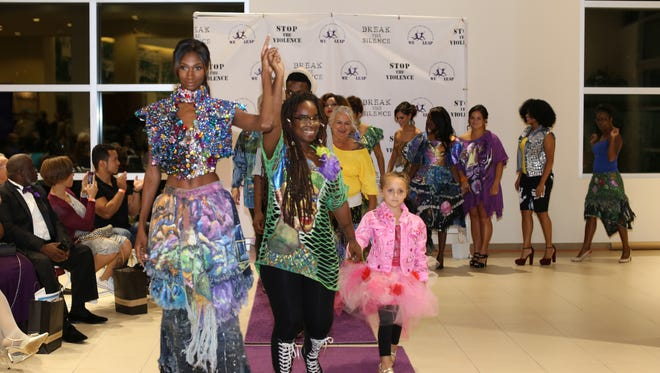 Featured model Kate Citrone, fashion denim designer Nfra, and model participants from the second annual Purple Tie Even greet the audience.