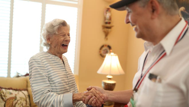 Virginia Carteeshares a laugh with Douglas Starr of Big Bend Hospice's Valor Team, who came to her daughter's home to conduct a ceremony for Cartee's World War II military service on Friday, Oct. 13, 2017.