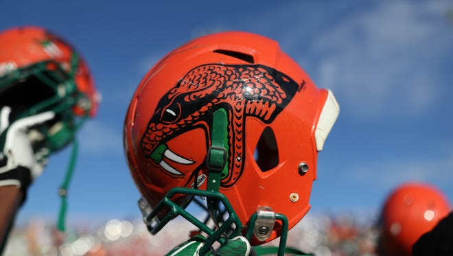 FAMU's players raise their helmets after their game against N.C. A&T at Bragg Memorial Stadium Saturday, Oct. 14, 2017.